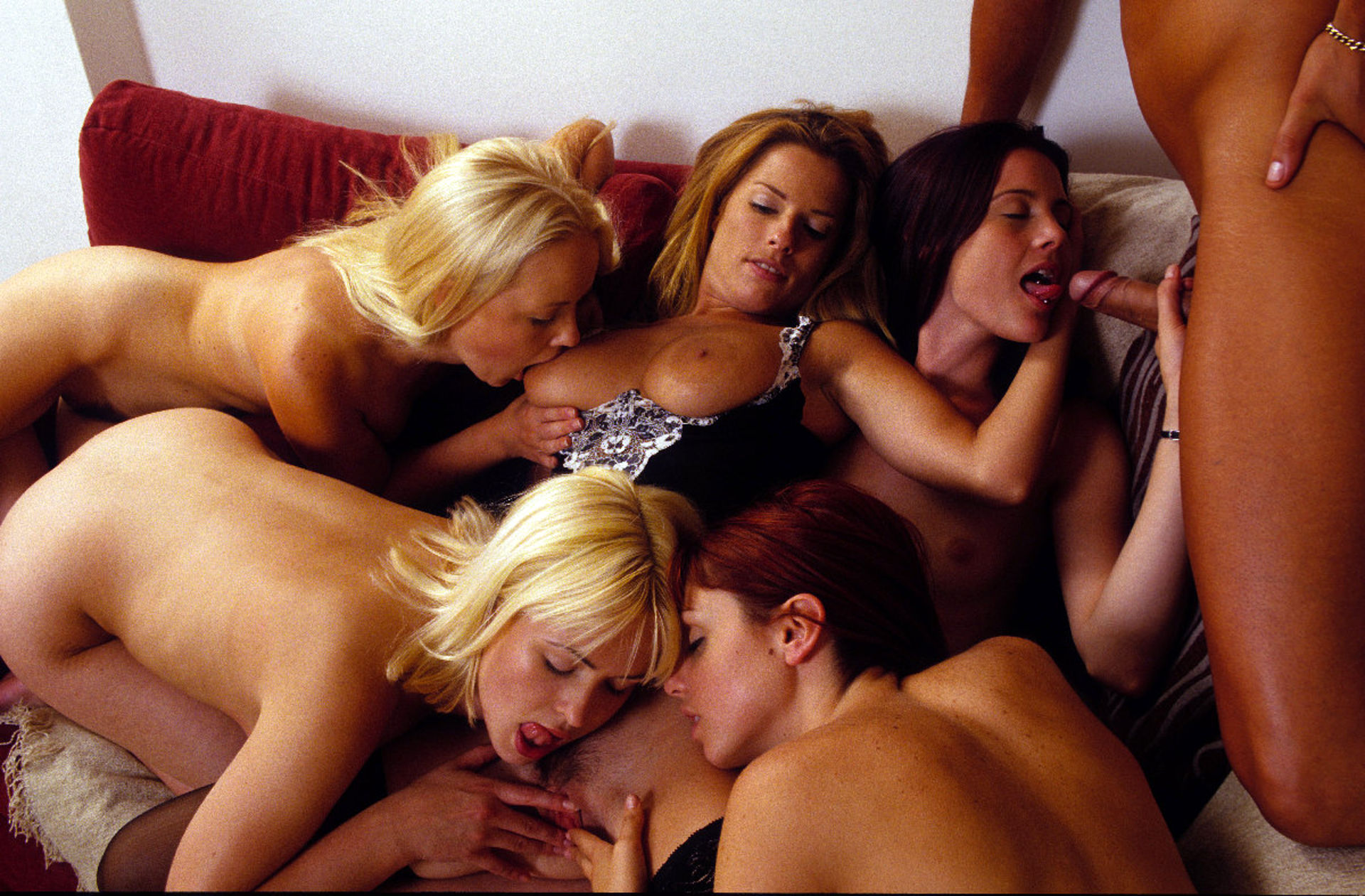 One lucky guy has an orgy with chick with dicks